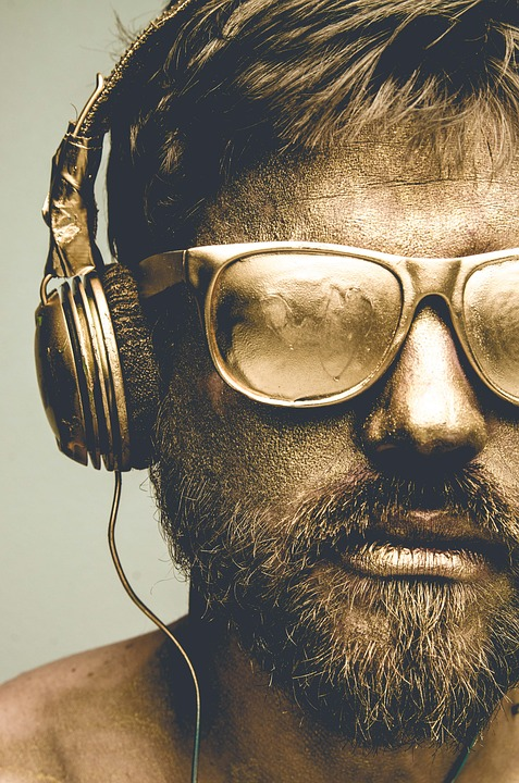 bearded man wearing headphones